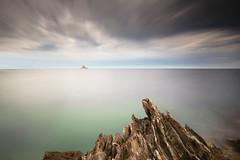 Lion before storm (Eugenios X.) Tags: nx300 poros lion longexposure beforethestorm seascape clouds rocks ocean greece
