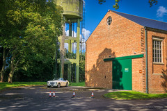 Austin Healey in the shadows (Jocke Selin) Tags: bicester trees convertible cabrio sundaybrunch bicesterheritage softtop cars austinhealey watertower building white classiccar