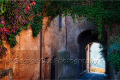 Entrance Gate of a Hilltop Town, Civita Di Bagboregio, Unbria, Italy (George Oze) Tags: building civitadibagnoregio exterior provinceofviterbo tuscany unbria ancient arches architecture buildingexteriors centralitaly city cityscape civita cobblestone colorful entrance europe europeanunion gate hilltoptown historic horizontal italian italy ivycovered landmark landscape mediterranean mountain nobody old outdoors plateau quaint rock romatic scenic stonebuilding street streetphotography town travel village umbria it