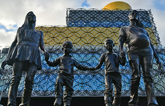 Family Reinvented (Vide Cor Meum Images) Tags: mac010665yahoocouk markandrewcoleman videcormeumimages vide cor meum markcoleman birmingham statue art sculpture family library looking up midlands england english city culture architecture buildings glass edifice
