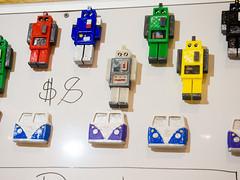 3-D printed VW Bus and robot magnets by Wendy Johnson, West Coasters (marketkim) Tags: holidaymarket stockingstuffers product soeug eugene oregon saturdaymarket festival artfair eugenesaturdaymarket artfestival