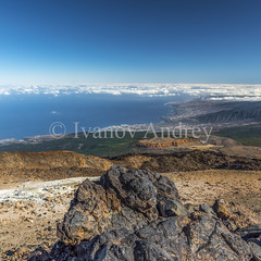 Mountains above the clouds (Ivanov Andrey) Tags: mountain volcano hill slope valley cloud sea coast rock sky skyline stone sand island plant flower bush grass yellow sulfurblack sun noon blue landscape perspective path road ascent descent shadow mountainrange mountainpeak nature travel tourism spain canaryislands tenerife teide