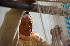A woman in training center for production of local  handicrafts (World Bank Photo Collection) Tags: people woman work handicraft tn jobs northafrica tunisia headscarf working craft skills countries development weave gender artisan worldbank loom elkef