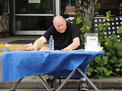 Holding On (knightbefore_99) Tags: life street city food vancouver table zoo italian bc fat bald coop commercialdrive eastvan hold flyaway carfreedays