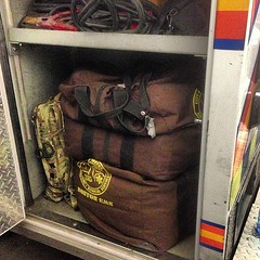 Our PPE (personal protective equipment) compartment. 45 pounds in each brown bag and whoever is driving's (me tonight) med bag #myemsnight #myemsday #bems #bostonems #ems #emspics #booboobus #paramedicproblems #911 #instamedics (Boston EMS Relief Association) Tags: instagram ifttt