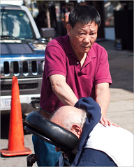 Street Massage & Worry (TheeErin) Tags: street orange shirt chair cone expression parking working sunny professional massage worried therapy relaxation polo therapeutic deeptissue