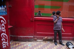 Red corner (Life in Frozen Frames) Tags: city red people india color water cigarette indian smoking cocacola bengal calcutta lifeinfrozenframes reemagill tamaghnasarkar 20131024dsc0413