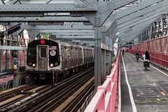M train on Williamsburg Bridge (grapfapan) Tags: nyc newyorkcity bridge bicycle train subway steel flickrandroidapp:filter=none