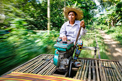 Driving the bamboo train (Lil [Kristen Elsby]) Tags: travel motion blur speed topf50 cambodia southeastasia transport lorry motionblur editorial topv4444 battambang travelphotography bambootrain battambangprovince norry canon5dmarkii