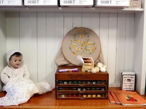 baby thread shop museum doll sampler blanket recreation burnabyvillagemuseum drygoodsstore