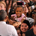 President Barack Obama shakes the hand of a  little girl after his speech.