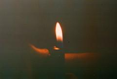tobacco stains (M a t t M a r s h) Tags: film beautiful fire hand kodak cigarette smoke flame lighter grainy praktika disposable kodakgold mtl5b