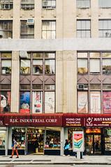Stacked (JoelZimmer) Tags: newyork vertical unitedstates manhattan streetphotography citygrid flatirondistrict 24mmf28 nikond7000