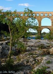 Pont du Gard (Row 17) Tags: bridge france building tourism water architecture buildings river arch riverside roman bridges engineering worldheritagesite rivers touristattraction ancientmonument