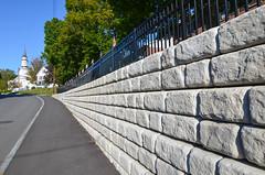 Redi-Rock-cobblestone-gravity-road-RRNE-MapleStreet-1.jpg (redirockphotodatabase) Tags: wallwithfence gravitywalls maplestreet gravity retainingwalls redirock lebanon cobblestone redirockofnewengland retainingwall lebanonnh road gravityretainingwalls cobblestoneface rrne wallwithfencing newhampshire fencing fence roadapplication retaining gravityblocks