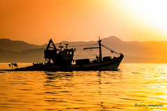 Bateau de pche - Maroc (Bouhsina Photography) Tags: coucher soleil sunset eau montagne silhouette reflection 2016 ttouan maroc morocco bouhsina bouhsinaphotography canon 7dii couleur brillant calme orange jaune brilliant wow