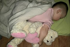 Edith sharing a nap with her bear today.
