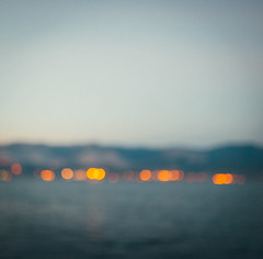 Defocused coastline after sunset, abstract photo (k_maxim) Tags: abstract defocus turkey photo bulb landmark shimmer night spectacle light spectacular shiny misty focus design color close city colorful mood beauty photographic blur scenic dawn lush feeling background beam bokeh coastline harbor harbour