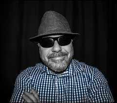 Blue checky shirt. (CWhatPhotos) Tags: photographs man male portrait self selfie me mine smile checked shirt checky hat tweed trilby wool fisheye view prime night time have it photograph pics pictures pic picture image images foto fotos photography artistic that which contain digital dark cwhatphotos 9mm bodycap body cap 9 mm lens olympus e5 mk2 omd shades sunglasses sun glassses specs select color colors colour colours partial blue selective
