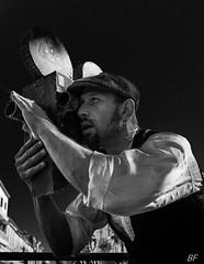 Street artist !! (poupette1957) Tags: art atmosphère black canon city curious french grandangle humanisme humour imagesingulières life monochrome man noiretblanc noir photographie people portrait rue street town urban ville cinema festival
