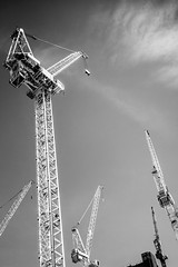 Uplifted (marktmcn) Tags: up upwards skywards cranes uplifted uplifting raised rise construction development build blackandwhite monochrome d610 nikkor mechanical crane