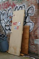 Not __ __IT (bballchico) Tags: door notit notanexit wall graffiti ballard