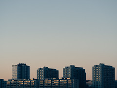 6.12. (miemo) Tags: architecture buildings city dusk em5mkii europe evening finland helsinki highrises merihaka olympus olympus60mmf28 omd reflections sky sunset urban windows winter