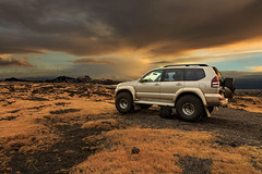 Light Chaser 1 (Pete 5D...©...) Tags: iceland stafnes reykjanes peninsula 4x4 ice tyres tires sky clouds mountain golden camera bag lava flow formation skyline blue skies range gold carbon tipped spikes