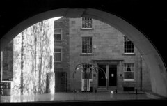Through the arched window (Man with Red Eyes) Tags: leicaiiicf iiicf barnack summar50mmf2 uncoated orwo orwon74 n74 td201 a3minsb3mins divided anchelltroop homedeveloped modifiedd23 twobath v850 analog blackwhite monochrome silverhalide 35mm film sunnysixteen coffeeshop lancaster lancashire jatkinsonco musicroom coffee window arch architecture view lookingout upstairs sun sunsquare
