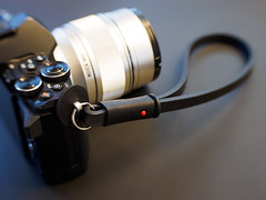 New Camera Strap (haslo) Tags: omd em1 em5ii strap olympus deadcameras leather gear equipment wrist black red trio28 lensbaby