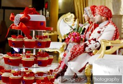 Wedding cake and bridal couple (Snappy Saffs) Tags: wedding red cakes cup cake female manchester photography cupcakes pretty weddingcake details bolton ur shaadi brideandgroom bridalcouple greatermanchester dulhan dulha desishaadi manchesterbasedweddingphotographer dulhanurdulha femaleweddingphotography