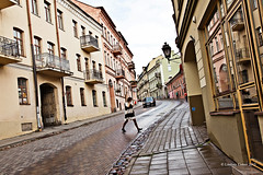 Uzupio (lindz.comer) Tags: street travel woman white black color lines architecture patterns angles historic curve vilnius uzupio