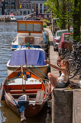 Canal Side Conversation (Pauls-Pictures) Tags: pictures street city girls two portrait urban woman colour netherlands girl amsterdam river boats photography canal women sitting photos pics candid pair side transport scenic bikes giving directions freinds photograhy canalside