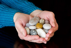 A Handful of Pebbles (Mukumbura) Tags: woman brown white nature closeup grey holding hands rocks hand stones fingers pebbles collection human colourful geology handful
