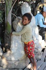 Hugging Buddha (10b travelling) Tags: boy statue stone hugging hug asia asien southeastasia buddha burma myanmar asie southeast birma mandalay indochine stonemason birmanie 2011 peopleset  iptcbasic