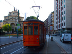 Trams in Milan, Italy (Nithi clicks) Tags: road street old city trip houses summer vacation sky urban italy orange milan tourism window public car electric architecture train vintage buildings one italian europe downtown cityscape traffic bright symbol outdoor walk trolley milano traditional capital ngc transport tram rail sunny cable transportation vehicle historical typical tramway ecological oldfashioned nithiclicks