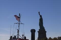 Lady Liberty (Tuck Happiness) Tags: nyc blue autumn sky usa newyork ferry flag statueofliberty ladyliberty starsstripes 2013