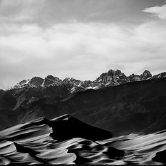 Dunes and Mountains (agavephoto) Tags: light shadow blackandwhite sunlight snow mountains square landscape sand colorado desert natural fineart curves minimal desolate greatsanddunesnationalpark vision:mountain=0798 vision:outdoor=0695 vision:sky=073 vision:clouds=0788 vision:ocean=0587