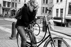 Girl thinking on a bike (Dontwannastop) Tags: street portrait people urban woman white house black holland building netherlands girl bike canal jean thinking meditation gouda