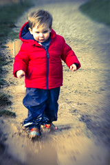 Serial Splasher_1846_By Phil Ovens (Pitcher_Phil) Tags: blue boy red portrait playing cute smiling lensbaby funny colours mud textures wellingtonboots colourful dexter puddles wellies playful f4 mu