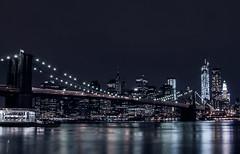 Brooklyn Bridge View at Night (mattinho2704) Tags: city nyc newyorkcity longexposure travel bridge sky usa ny newyork tower water skyline brooklyn night america freedom nikon nightshot manhattan brooklynbridge bigapple freedomtower brooklynpark 5photosaday flickraward nikond300 flickraward5