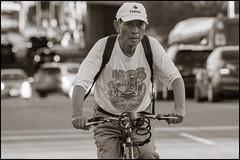 Canada Rider on Bank Street (Dan Dewan) Tags: centretown dandewan bicycle canon7dmarkii canonef70200mm14lisusm street tuesday bike september blackwhite hat cyclist ottawa summer man portrait  male photographist ontario bankstreet bw face canon 2016