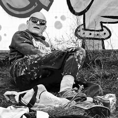 Sometimes a graffiti artist needs a rest (Akbar Simonse) Tags: dscn4840 rotterdam holland netherlands nederland lastplak people men graffitiartist streetphotography straatfotografie zwartwit bw blancoynegro bn monochrome vierkant square akbarsimonse sunglasses shades zonnebril