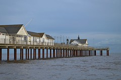 Southwold Pier, Suffolk (DaveJC90) Tags: suffolk southwold pier souhtwoldpier building old classic wood metal lighthouse sea water northsea long exposure autumn winter sunrise sunset sun sunny sunlight light bright night sky blue cloud cloudy dark shadow beach bay hut huts reflection wave waves move movement colour colours crop croped nikon d5100 digital slr camera wide angle zoom lens 1020mm 1855mm detail sharp sharpness