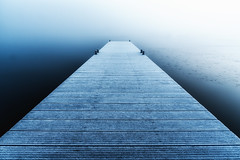 Frozen pier on a foggy morning (Gabe de Jong) Tags: pier lake water frozen blue bluehour minimalism perspective texture fog goggy mist ice sunset darkness