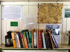 Shack bookshelf. West Cove, Erith Island.