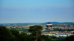 datum (doods-Internet so slow :-o) Tags: hills ballon festival houses sky cloudy trees