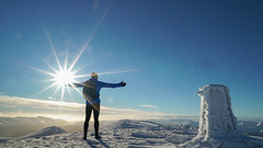 Sunshine on Skiddaw (www.AlastairHumphreys.com) Tags: skiddaw running run mountain sun sunrise sunburst cairn snow ice blue winter