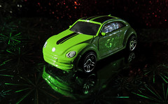 Christmas time (is here again) (Sky_PA (On and Off)) Tags: toy showroom vwbeetle christmastimeishereagain deepfriedworms thebeatles christmaslights volkswagen automobile auto beatlesbeetles macromondays green neon reflection colors volky beetle diecast model hotwheel