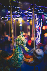 2016187 (gwagwa) Tags: merrygoround amusement seahorse light bokeh green violet mitakon 50mm f095 colors